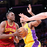 14 January 2014: Cleveland Cavaliers small forward Luol Deng (9) drives past Los Angeles Lakers small forward Nick Young (0) during the Cleveland Cavaliers 120-118 victory over the Los Angeles Lakers at the Staples Center, Los Angeles, California, USA.