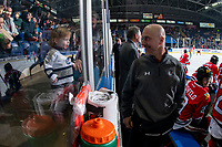 KELOWNA, CANADA - MARCH 3:  Portland Winterhawks' athletic therapist Rich Campbell smiles at a young fan from the bench against the Kelowna Rockets on March 3, 2019 at Prospera Place in Kelowna, British Columbia, Canada.  (Photo by Marissa Baecker/Shoot the Breeze)