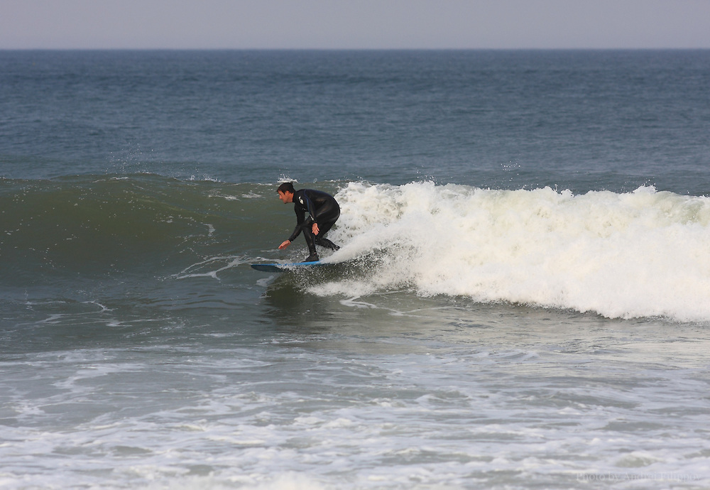 Surfer at the Marconi Beach, Cape Cod, Massachusetts, USA, September 3, 2011.