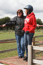 Women with visual impairments waiting for riding lesson.