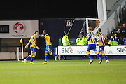 Goal! Shaun Whalley of Shrewsbury Town is congratulated by his team mates after making it 2-1 during the Sky Bet League 1 match between Shrewsbury Town and Coventry City at Greenhous Meadow, Shrewsbury, England on 8 March 2016. Photo by Mike Sheridan.