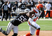Sep 30, 2018; Oakland, CA, USA; Browns running back Nick Chubb (24) eludes Raiders linebacker Tahir Whitehead (59) for a 63-yard touchdown during a game between the Oakland Raiders and the Cleveland Browns. The Raiders defeated the Browns 45-42 in overtime. Mandatory Credit: Spencer Allen-Image of Sport