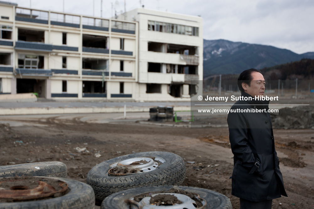 Futoshi Toba, Mayor of Rikuzentakatata city, stands within the desolated landscape where his city once stood, before it was destroyed by the March 11th 2011 tsunami, in Rikuzentakatata, in Tohoku area, Japan, on Monday 23 January 2012. Futoshi Toba is 1year into a 4year term as Mayor, and he lost his wife, Kumi, in the earthquake and tsunami disaster. He now lives with his two sons, alongside other relatives.