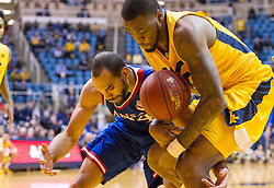 Jan 12, 2016; Morgantown, WV, USA; Kansas Jayhawks forward Perry Ellis (34) and West Virginia Mountaineers forward Elijah Macon (45) fight for a loose ball during the first half at the WVU Coliseum. Mandatory Credit: Ben Queen-USA TODAY Sports