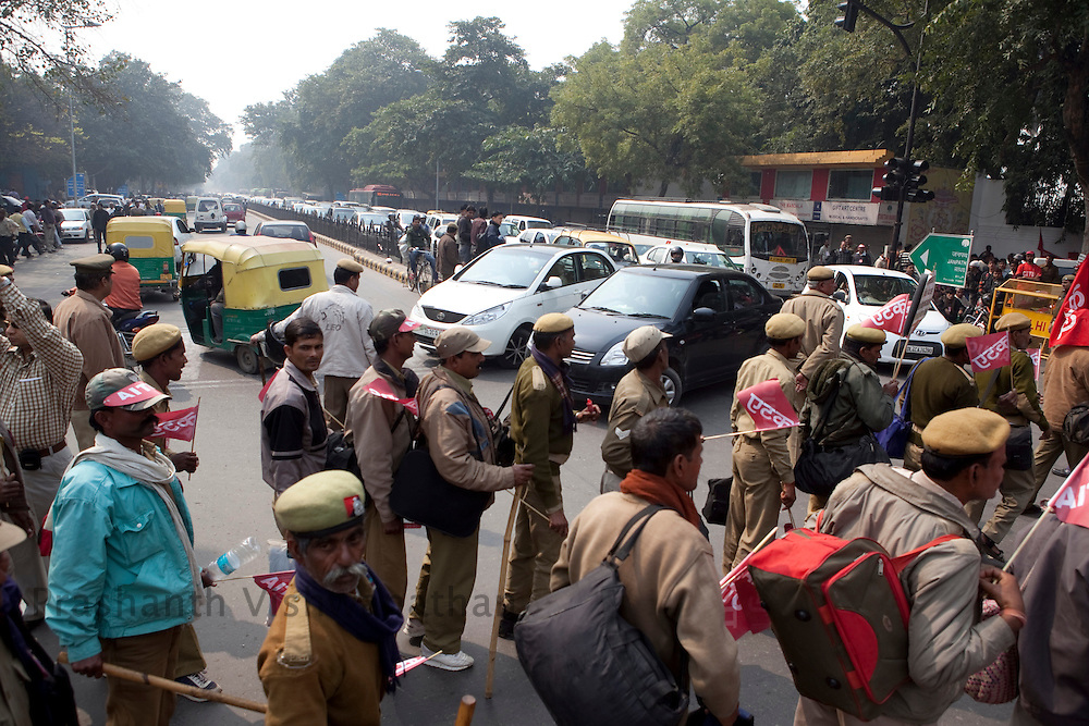 Workers from trade unions across the country  block traffic at Janpat Market area while on a march to the parliment street protesting against rising food prices, low wages and job security, New Delhi, India, on Wednesday, February 23, 2011. Photographer: Prashanth Vishwanathan/Bloomberg News