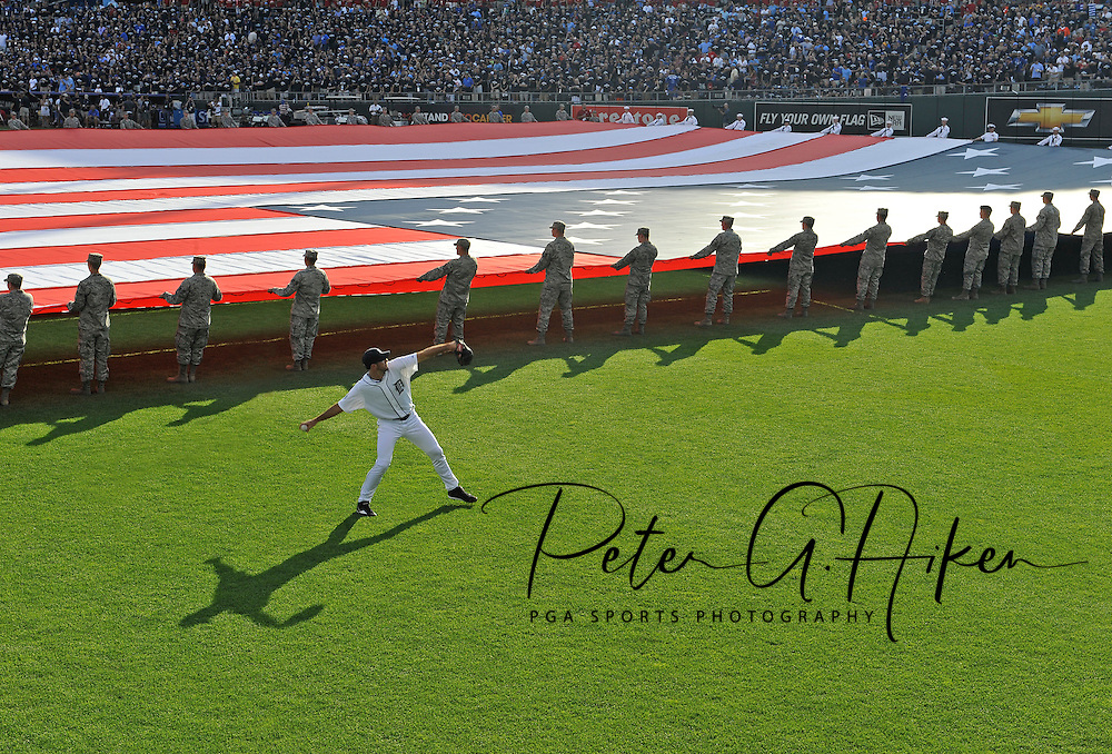 Fox Sports -- American League pitcher Justin Verlander (35) of the Detroit Tigers warms up in the outfield as a large American flag is unfurled before the 2012 MLB All Star Game at Kauffman Stadium. .