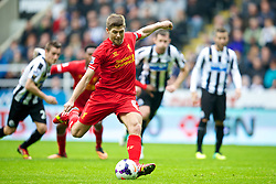 NEWCASTLE-UPON-TYNE, ENGLAND - Saturday, October 19, 2013: Liverpool's captain Steven Gerrard scores the first goal against Newcastle United from the penalty spot, his 100th League goal, during the Premiership match at St. James' Park. (Pic by David Rawcliffe/Propaganda)