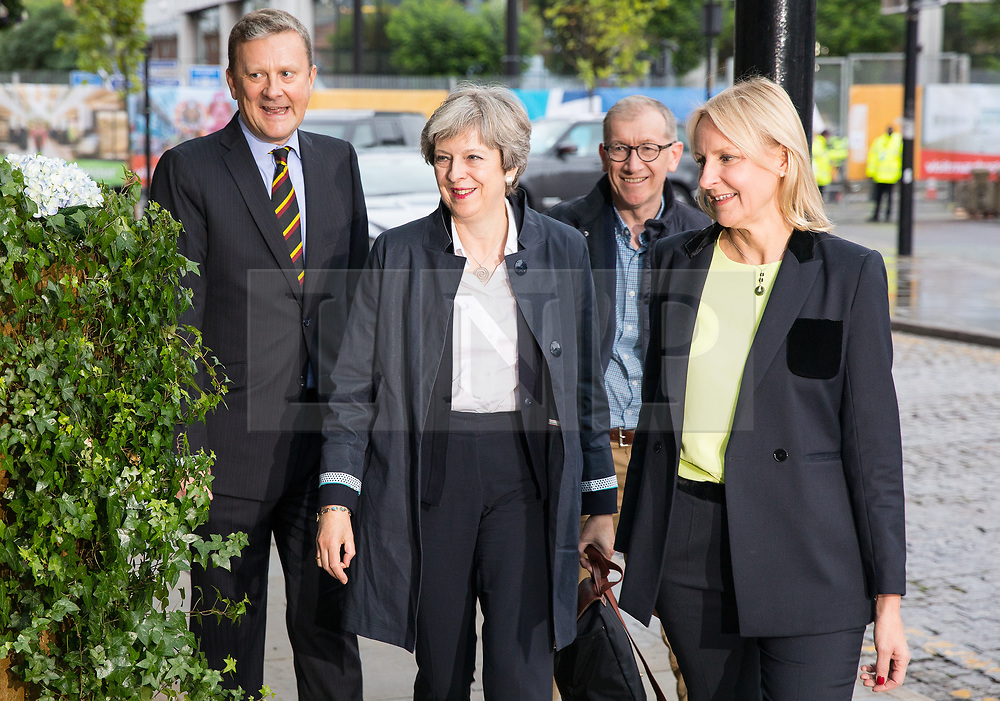 © Licensed to London News Pictures . 30/09/2017. Manchester, UK.  Prime Minister THERESA MAY and husband PHILIP MAY arrive at the Midland Hotel , greeted by ANDREW SHARPE (l), President of the National Conservative Convention , and his wife FIONA (r) .  Manchester prepares for the Conservative Party Conference , which is taking place inside a secured zone around the Manchester Central Convention Centre . Photo credit: Joel Goodman/LNP