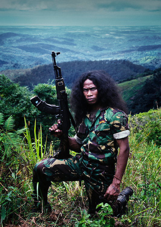 Dan Kiak Raten Laek.<br /> <br /> A Falintil soldier whose name means 'the poor one who dies without a grave'.<br /> <br /> He is a survivor of the massacre at the Santa Cruz Cemetery in Dili in 1991.<br /> <br /> He was 15 at the time and escaped to the forest where he has lived as a member of the Falintil ever since.<br /> <br /> East Timor, March 1999.