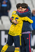 Gabriel Martinelli (Arsenal) getting a hug following the Premier League match between West Ham United and Arsenal at the London Stadium, London, England on 9 December 2019.