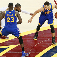 10 June 2016: Cleveland Cavaliers guard Kyrie Irving (2) defends on Golden State Warriors guard Stephen Curry (30) next to Golden State Warriors forward Draymond Green (23) during the Golden State Warriors 108-97 victory over the Cleveland Cavaliers, during Game Four of the 2016 NBA Finals at the Quicken Loans Arena, Cleveland, Ohio, USA.