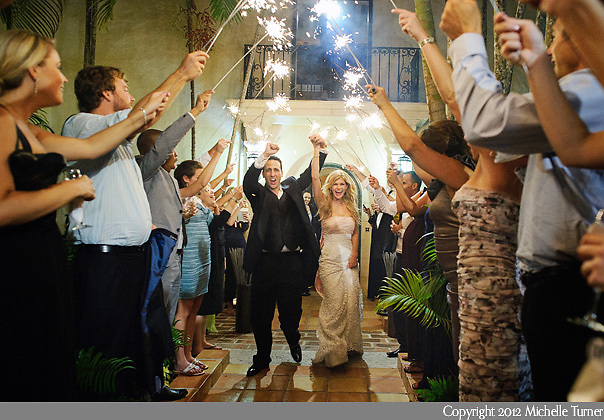 A sparkler exit at this Villa Woodbine Wedding in Coconut Grove, Florida.  Image by destination wedding photographer Michelle Turner.
