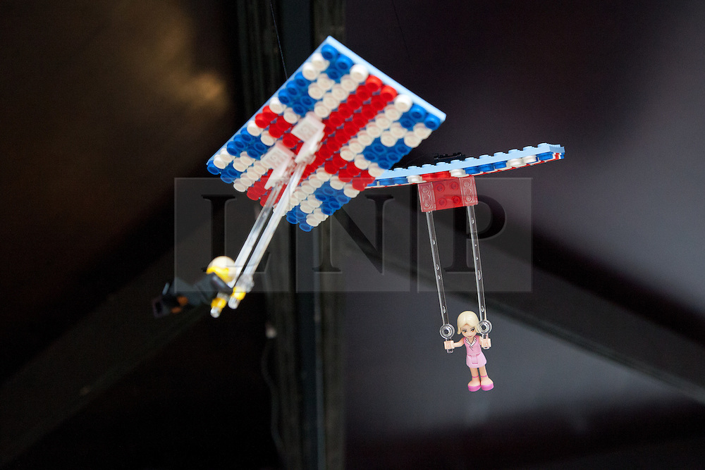© Licensed to London News Pictures. 05/07/2012. London, UK. Minature LEGO replica parachuters from the Opening Ceremony of the Olympic Games fly from the ceiling above a replica of the Olympic stadium and Orbit. LEGO creator, Warren Elsmore used around 250,000 standard LEGO bricks to create a miniature replica of the London 2012 Olympic Games Park. The model took Warren, aged 35 from Edinburgh, 300 hours to construct and is on display at the 'Visit Denmark' Olympic Village  at St Katharine Docks, London. Photo credit : Vickie Flores/LNP