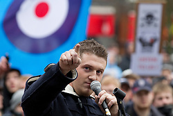 © under license to London News Pictures. 05/02/2011. Stephen Lennon (aka Tommy Robinson), the leader of the English Defence League, addresses a crowd. Thousands of English Defence League members and supporters march through Luton Town Centre to demonstrate against Sharia Law. 2000 police are in the town to keep the peace. Joel Goodman/London News Pictures