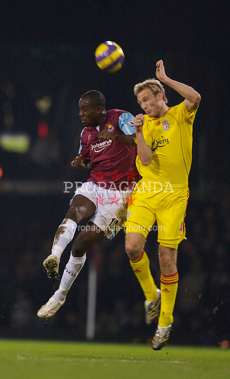 London, England - Tuesday, January 30, 2007: Liverpool's Sami Hyypia and West Ham United's Carlton Cole during the Premiership match at Upton Park. (Pic by David Rawcliffe/Propaganda)