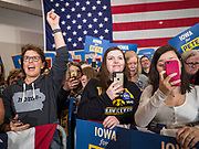 08 DECEMBER 2019 - CORALVILLE, IOWA: A woman cheers while others photograph on their smart phones at Mayor Pete Buttigieg enters a campaign event in Coralville, IA, Sunday. Buttigieg, the mayor of South Bend, Indiana, is running to be the Democratic nominee for President in the 2020 election. Iowa traditionally holds the first presidential selection event of the 2020 election cycle. The Iowa Caucuses are on Feb. 3, 2020.    PHOTO BY JACK KURTZ