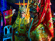 "26 FEBRUARY 2018 - BANGKOK, THAILAND: Performers backstage during a Chinese Opera at the Phek Leng Shrine in the Khlong Toey section of Bangkok. The shrine traditionally hosts a Chinese Opera just after the end of Lunar New Year festivities. Thailand is home to the largest population of overseas Chinese in the world, and Chinese cultural practices, like Chinese opera, called ""ngiew"" in Thailand, are popular. Many of the performers are ethnic Thais who don't speak Chinese. They learn their lines phonetically.     PHOTO BY JACK KURTZ"