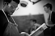 Med School students at Harvard University spend a semester in Gross Anatomy, learning the ins and outs of the human body at the beginning of their medical training.  Reading along, students help each other.