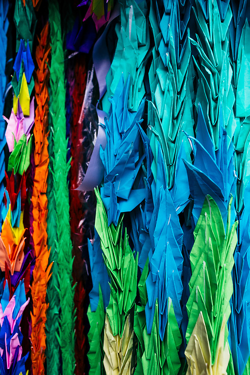 Origami cranes--a symbol of peace--decorate an altar near the Nagasaki Atomic Bomb Museum in Nagasaki, Japan.