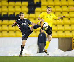 Falkirk's Luke Leahy and  Livingston Gary Glen.<br /> Half time : Livingston 0 v 1 Falkirk, Scottish Championship played13/12/2014 at The Energy Assets Arena.