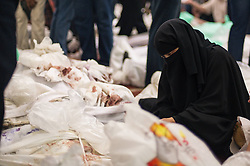 60360916  <br /> An Egyptian woman stares at dead bodies at a mosque where lines of bodies wrapped in shrouds were laid out in Cairo, Egypt, August 15, 2013. At least 525 were killed and 3,717 others injured across Egypt in clashes between supporters of ousted President Mohamed Morsi and the security troops, after the latter dispersed Wednesday two major pro-Morsi sit-ins in Cairo and Giza, a Health Ministry official said Thursday, August 15, 2013. <br /> Picture by imago / i-Images<br /> UK ONLY