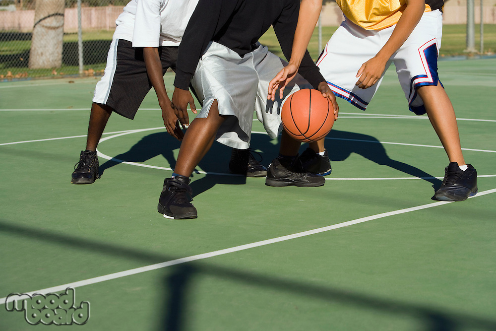 Player being tackled in basketball low section
