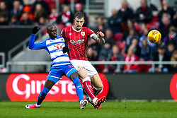 Modou Barrow of Reading and Aden Flint of Bristol City compete for the ball - Rogan/JMP - 26/12/2017 - Ashton Gate Stadium - Bristol, England - Bristol City v Reading - Sky Bet Championship.