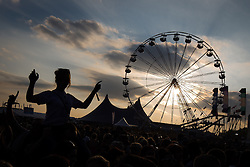 © Licensed to London News Pictures . 09/06/2013 . Heaton Park , Manchester , UK . Revellers in front of the main stage as the sun sets at the end of the weekend . Day 2 of the Parklife music festival in Manchester on Sunday 9th June 2013 . Photo credit : Joel Goodman/LNP