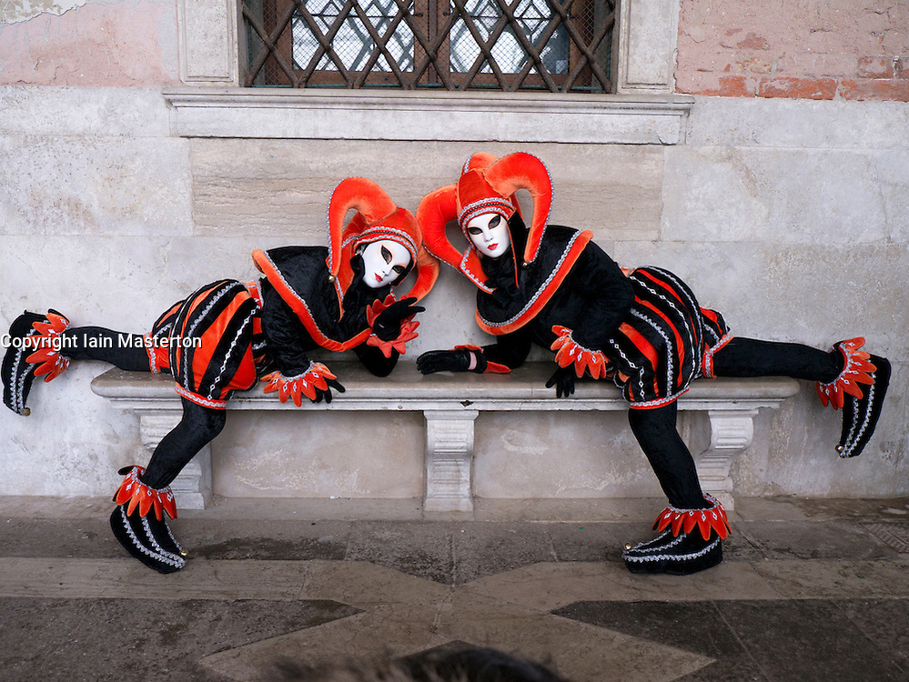 Masked women in Carnival or Carnevale in Venice Italy
