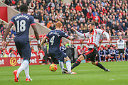 Newcastle United midfielder Jack Colback and Sunderland forward Steven Fletcher battle  during the Barclays Premier League match between Sunderland and Newcastle United at the Stadium Of Light, Sunderland, England on 25 October 2015. Photo by Simon Davies.