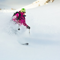 A telemark skier, Missy Thompson, making some early season turns on Berthod Pass, CO.