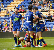 Bryson Goodwin (R) of Warrington Wolves celebrates scoring the try against Bradford Bulls with his team mates during the Ladbrokes Challenge Cup match at the Halliwell Jones Stadium, Warrington<br /> Picture by Stephen Gaunt/Focus Images Ltd +447904 833202<br /> 21/04/2018