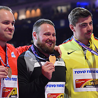 Tom Walsh receives his medal for the men's shot put at the IAAF World Indoor Championships, March 3, 2018