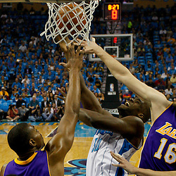 April 28, 2011; New Orleans, LA, USA; New Orleans Hornets center Emeka Okafor (50) shoots over Los Angeles Lakers power forward Pau Gasol (16) and center Andrew Bynum (17) during the first quarter in game six of the first round of the 2011 NBA playoffs at the New Orleans Arena. The Lakers defeated the Hornets 98-80 to advance to the second round of the playoffs.   Mandatory Credit: Derick E. Hingle