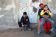 Asmahan Abu-Rahma enjoys her work and her children enjoy its fruits including the raw honeycomb which, even early in the season contains small amounts of honey. <br /> Asmahan Abu-Rahma and her children, Bil'in, Ramallah, West Bank, Palestine.