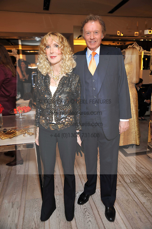 RICHARD & BASIA BRIGGS at a party to celebrate the arrival of the 'A Princess to be a Queen' collection at the Roger Vivier boutique on Sloane Street, London on 20th October 2009.