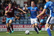 Callum Camps looks for a pass during the EFL Sky Bet League 1 match between Rochdale and Scunthorpe United at Spotland, Rochdale, England on 12 August 2017. Photo by Daniel Youngs.
