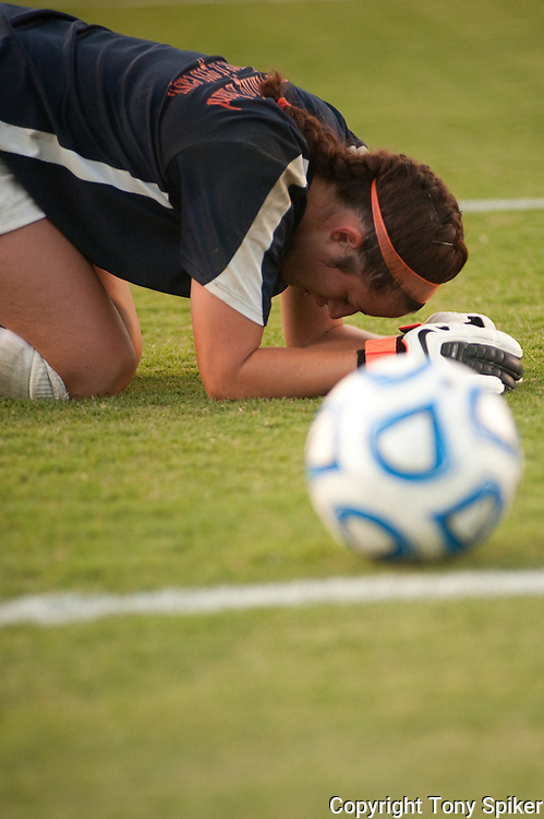 September 22, 2011.  Fullerton California.  Goalie Lindsay Maricic grimaces in pain during warmups before a game against the USD Torreos.