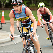 Triathletes stands on bike to accerlate