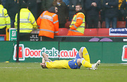 Leeds United defender Liam Cooper (6) goes down injured during the EFL Sky Bet Championship match between Sheffield United and Leeds United at Bramall Lane, Sheffield, England on 1 December 2018.