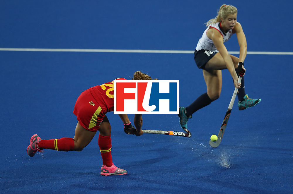 RIO DE JANEIRO, BRAZIL - AUGUST 15:  Xantal Gine of Spain shoots past Sophie Bray during the Women's quarter final hockey match between Great Britain and Spain on Day10 of the Rio 2016 Olympic Games held at the Olympic Hockey Centre on August 15, 2016 in Rio de Janeiro, Brazil.  (Photo by David Rogers/Getty Images)