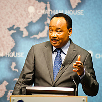HE Mahamadou Issoufou, President of the Republic of Niger, speaks and gestures from the podium during the ?Niger?s Growing Regional and International Importance? conference at Chatham House.