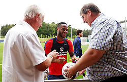 England's Raheem Sterling signs autographs for fans  - Mandatory by-line: Matt McNulty/JMP - 29/08/2017 - FOOTBALL - St George's Park National Football Centre - Burton-upon-Trent, England - England Training and Press Conference