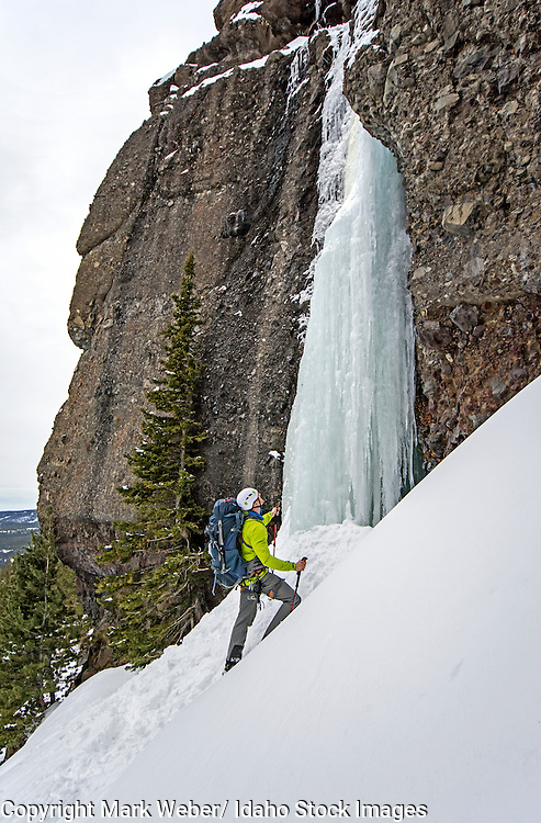 Elijah Weber approaching a ice climbing a route called Hang Over which is rated WI-3 and located in Hyalite Canyon in the Gallatin Mountains near the city of Bozeman in southern Montana