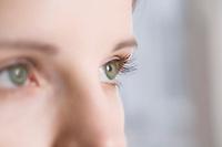 Caucasian woman's green eyes