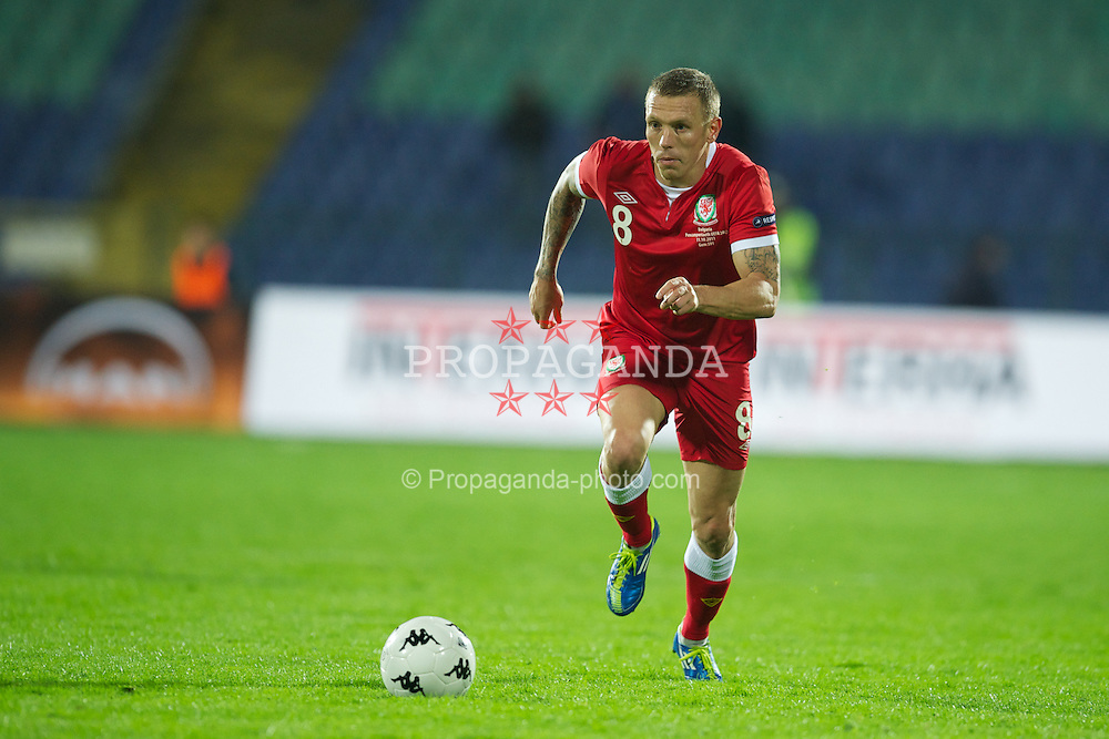 SOFIA, BULGARIA - Tuesday, October 11, 2011: Wales' Craig Bellamy in action against Bulgaria during the UEFA Euro 2012 Qualifying Group G match at the Vasil Levski National Stadium. (Pic by David Rawcliffe/Propaganda)