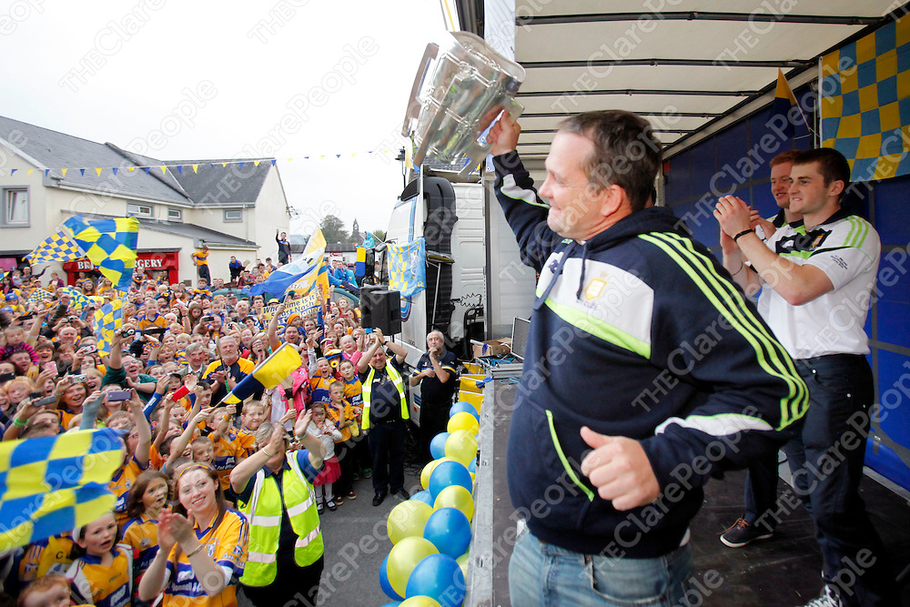 29/09/2013<br /> Clare Senior Hurling Manager Davy Fitzgerald presents the Liam McCarthy Cup to the large crowd who gathered  to welcome home the Senior and U21 All Ireland Winning teams to Sixmilebridge on Sunday Evening.<br /> Picture: Don Moloney / Press 22
