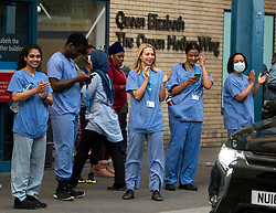 © Licensed to London News Pictures. 07/05/2020. London, UK. Medical staff at St Mary's Hospital in Paddington, West London take part in 'Clap For Our Carers' by applauding NHS workers, carers and key workers. Government is set to announce measures to easy lockdown, which was introduced to fight the spread of the COVID-19 strain of coronavirus. . Photo credit: Ben Cawthra/LNP