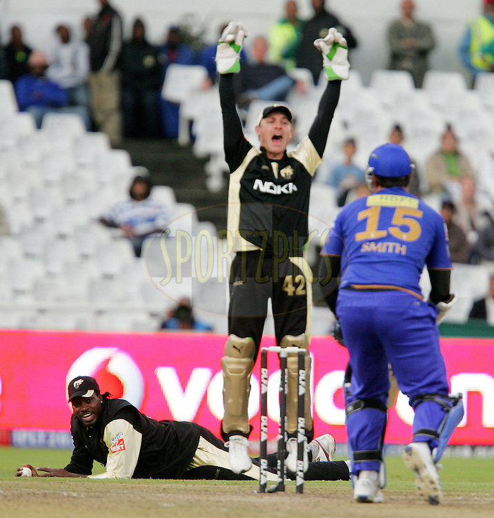 CAPE TOWN, SOUTH AFRICA - 23 April 2009. Chris Gayle lies with the ball after catching Graeme smith from the bowling of Mendis while Brendon McCullam appeals during the  IPL Season 2 match between the Kolkata Knight Riders and the Rajasthan Royals held at Sahara Park Newlands in Cape Town, South Africa..