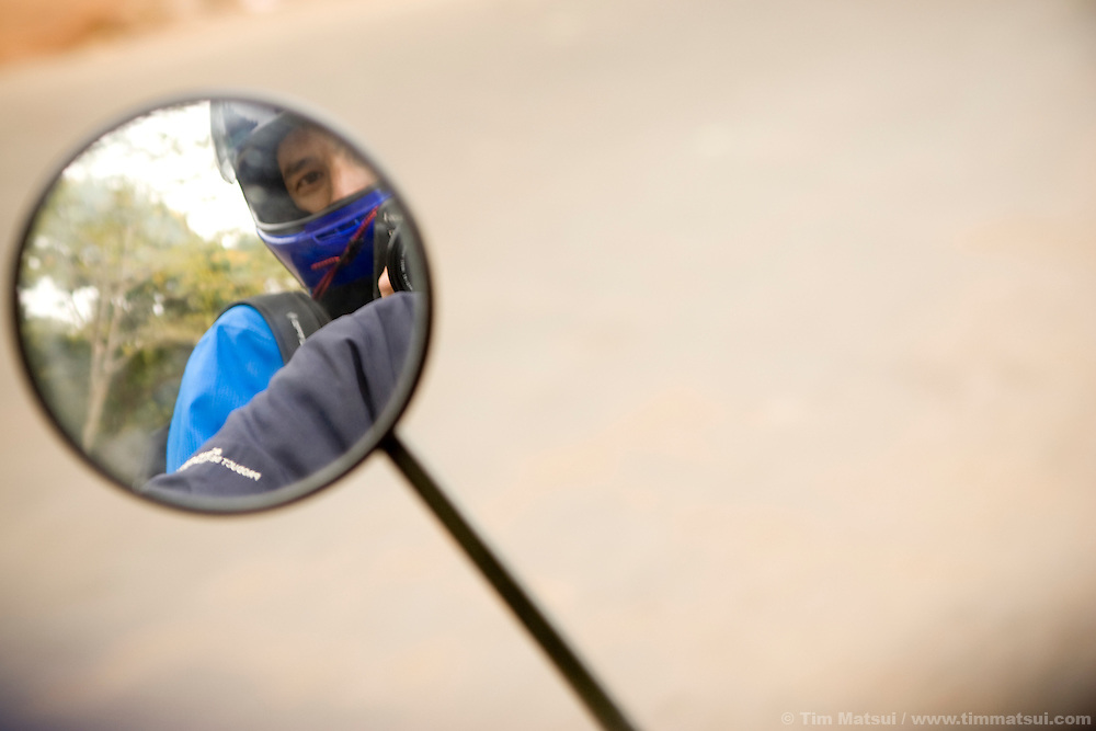 Self portrait on Kath's motorcycle, Phnom Penh, Cambodia.